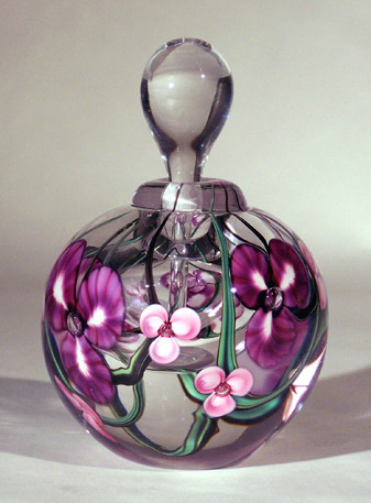 pink and purple flowers on clear glass keepsake urn