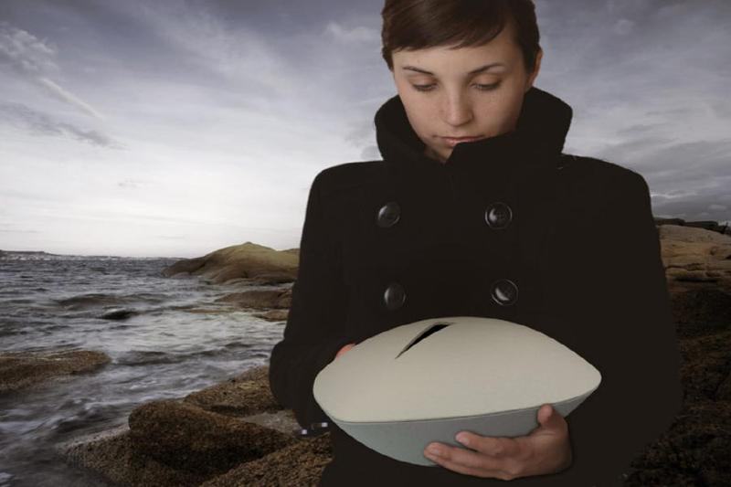 Girl holding sea urn