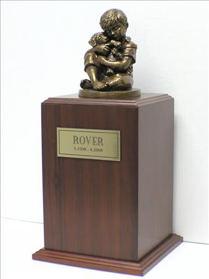 little boy holding puppy bronze sculpture urn