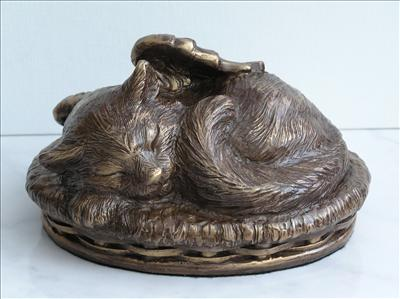 bronze cat angle in basket  urn
