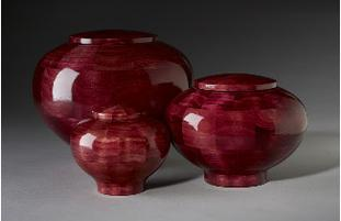 Red dyed wood cremation urns
