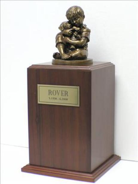 walnut urn with bronze sculpture of boy holding puppy