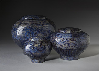 Wood cremation urns dyed blue